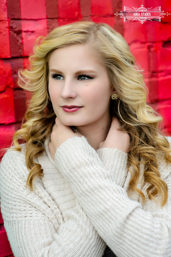 Denver senior pictures on red wall
