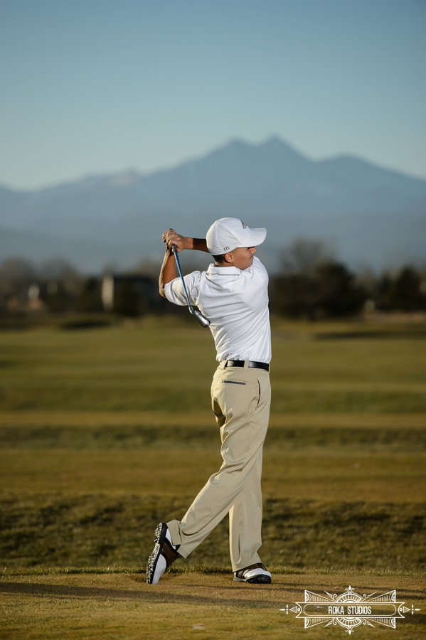 senior photo with golf and mountains