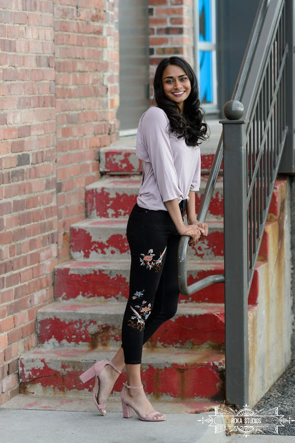 Denver urban senior pictures of a girl in floral print jeans. Stylish senior pictures